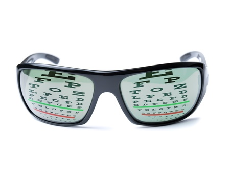 Modern dioptric sunglasses with Snellen eye chart as reflection on it  photo