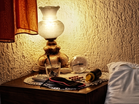 Accessories on the bedside table for typical sleepless nights Stock Photo - 14352068