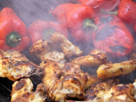 Closeup view of delicious barbecue meal with chicken wings and peppers  photo