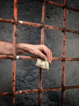 Conceptual image about bribery and corruption in prisons  photo