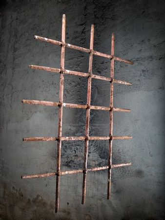 Rusty iron grille on a grunge background  photo