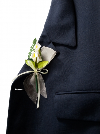 Lapel of suit jacket with floral decorations for wedding. photo