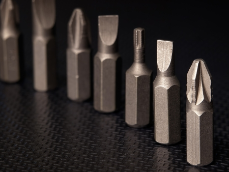 replaceable: Macro of various types of screwdriver heads  Stock Photo