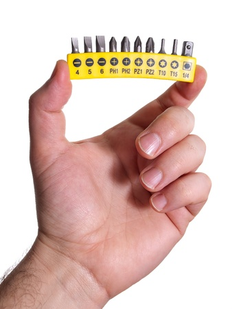 replaceable: Man is holding a set of various screwdriver heads on a white background