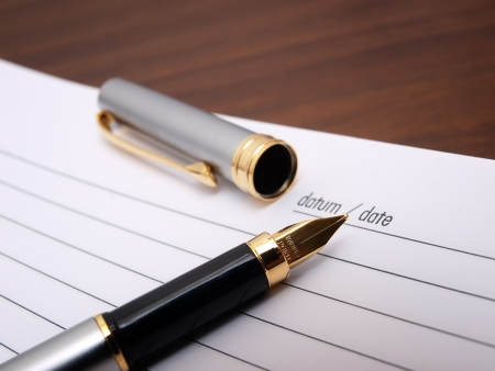 Closeup view of a  fountain pen and diary book