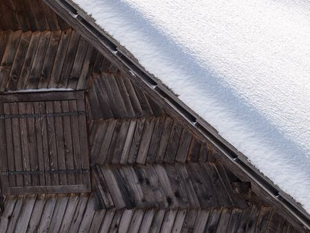 Detail of an old wooden snow shack somewhere in mountains  photo