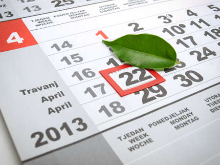 save time: Earth day marked on the calendar with a leaf as a symbol