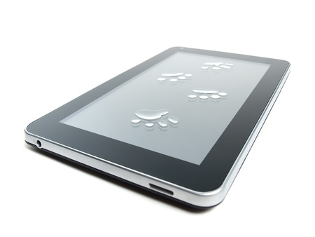 Tablet or pad device with paw prints on it on a white background  photo