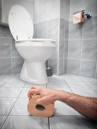 Concept image of digestive problems and difficulties in the toilet  Stock Photo