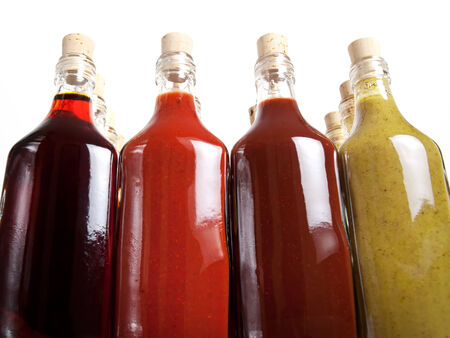 vinegar bottle: Many different hot barbecue sauces. Stock Photo