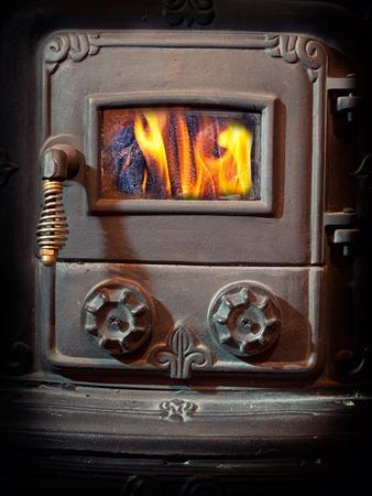woodburner: Firebox door of a retro wood burning stove.