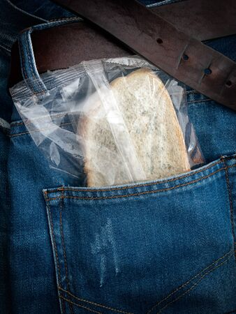 pauperism: Packed moldy slice of bread in the pocket.