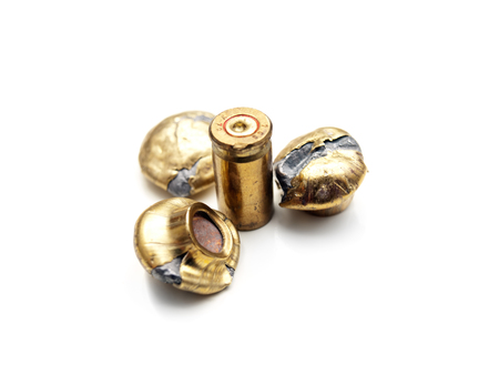 Fired bullets and a shell on a white backgorund.