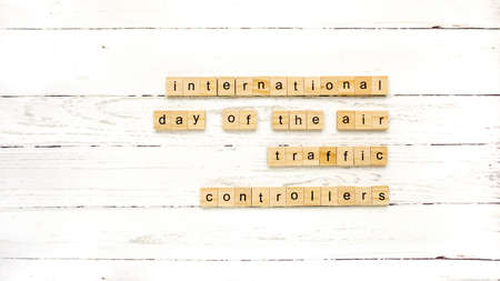 international air traffic controller day. words from cubes. photo