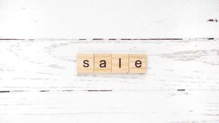 World day of shopping. words from wooden cubes with letters
