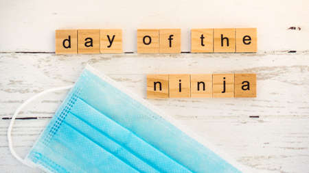 Day of the Ninja.words from wooden cubes with letters photo