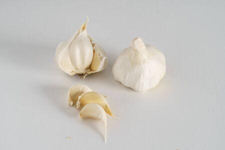 garlic bulbs on white