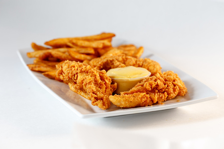 chicken fingers with fries and mustard sauce