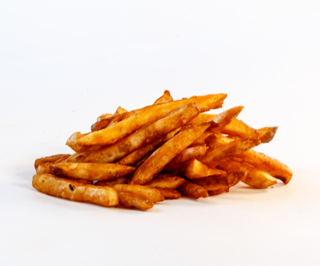 pile of french fries on white Reklamní fotografie