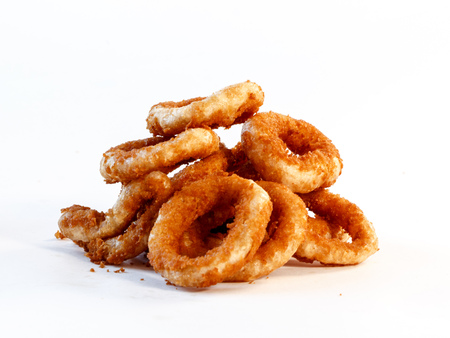 pile of onion rings on white