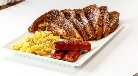 french toast with scrambled eggs and sausage Фото со стока