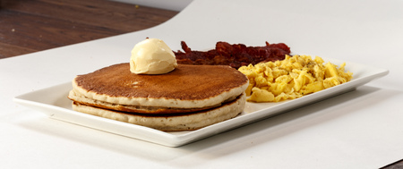 pancakes with bacon and scrambled eggs