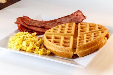 breakfast with waffle, egg and turkey bacon Фото со стока