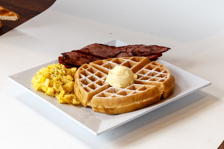 breakfast with waffle, egg and turkey bacon Imagens