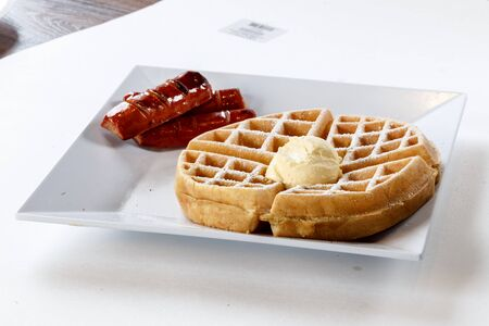 belgian waffle on plate with butter and sausage 版權商用圖片 - 83785377