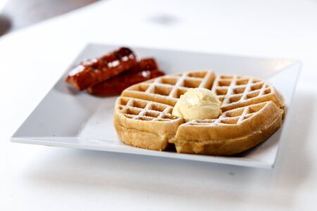 belgian waffle on plate with butter and sausage 版權商用圖片 - 83785388