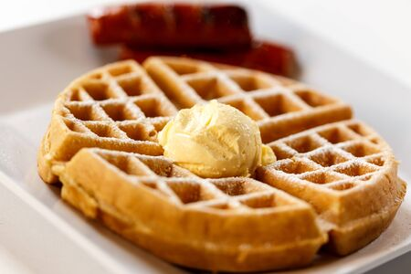 belgian waffle on plate with butter and sausage 版權商用圖片 - 83785386