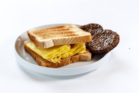breakfast sandwich with egg and sausage Фото со стока - 83785450