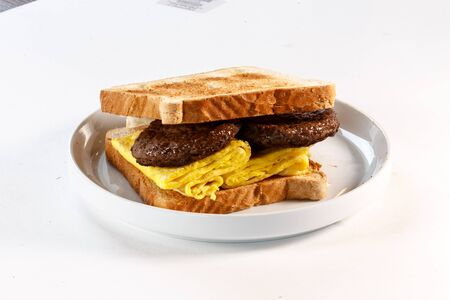 breakfast sandwich with sausage and egg