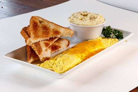 omelet with toast and grits