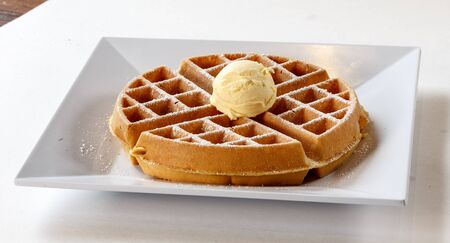 belfian waffle on plate with butter Imagens