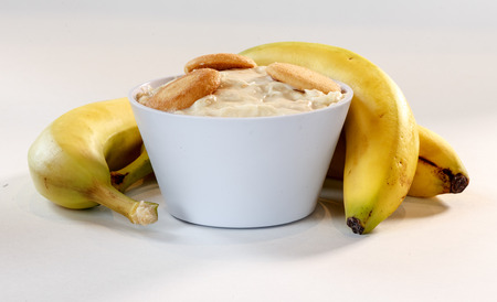 banana pudding in cup with cookies and fruit