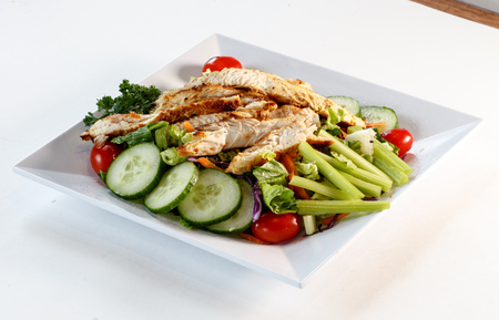 Green salad with sliced chicken breast