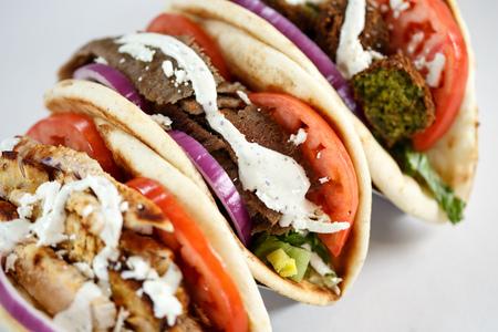 Chicken, Lamb and Falafel gyros Фото со стока