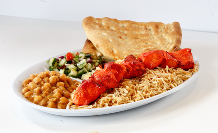 Chicken Tikka kabobs with rice and chick peas Stock Photo