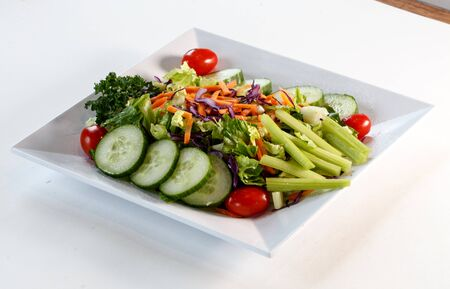 green salad on plate with cucumbers Фото со стока