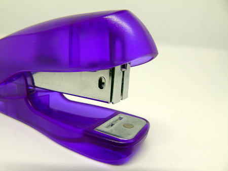 Purple Stapler Isolated on White Background Stock Photo