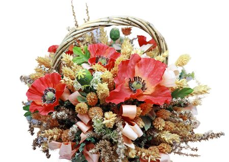 Closeup of Basket of Dried Flowers with Red Poppies Isolated on White Background