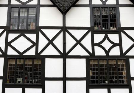 Closeup of Windows on Traditional English Black and White Tudor House