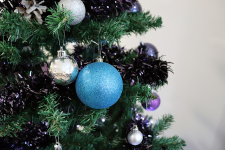 Closeup of Baubles Hanging on Christmas Tree with White Background Imagens