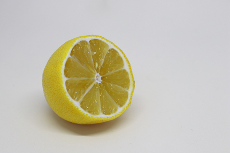 Closeup of Section of Lemon Isolated on White Background