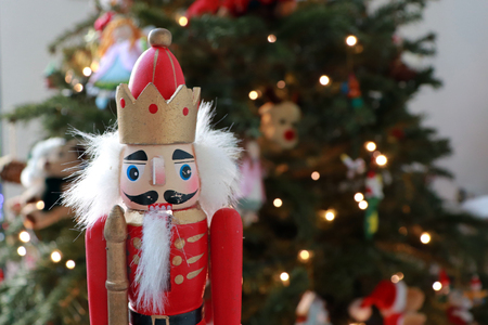 Nutcracker Decoration In Front of Christmas Tree