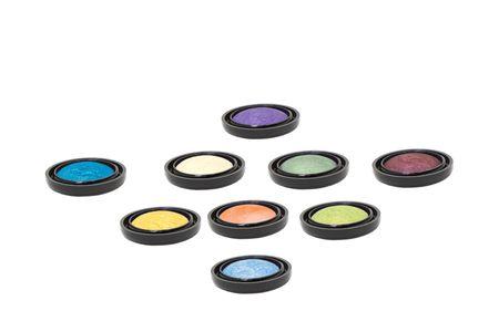 nine colored shiny make-up eyeshadows isolated in white  Stock Photo - 6528395