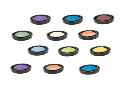nine colored eyeshadows in  horizontal lines isolated in white  Stock Photo - 6528398