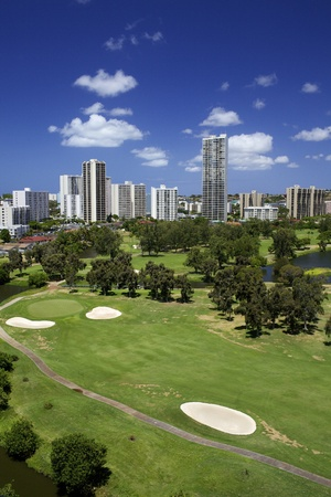 Golf Course with High Rise Buildings photo