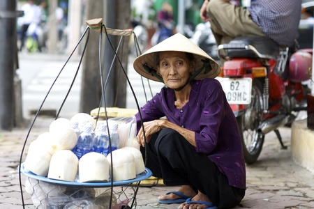 chi: 2: Unidentified woman street vendor in Ho Chi Minh City, Vietnam selling coconuts and water on June 2, 2008